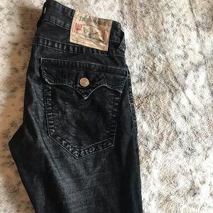 True Religion black corduroy feel type of Jean.